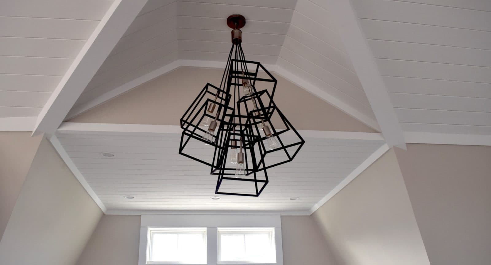 Modern Light Fixture installed in Bay Side Beach House Featured Installation with Shiplap Walls and Ceiling