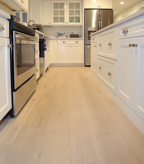 Sawyer Mason Structured Wide Plank Dune installed in Cozy Cottage Renovation Kitchen