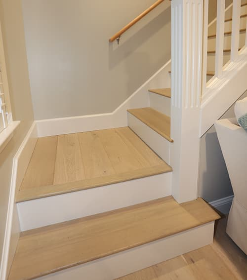 Matching Dune Stair Treads installed in Cozy Cottage Renovation