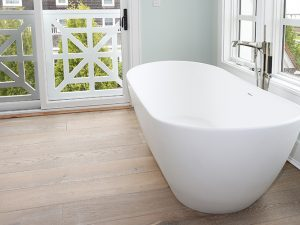 Wire Brushed Oak Flooring Miacomet installed in bathroom with modern bathtub